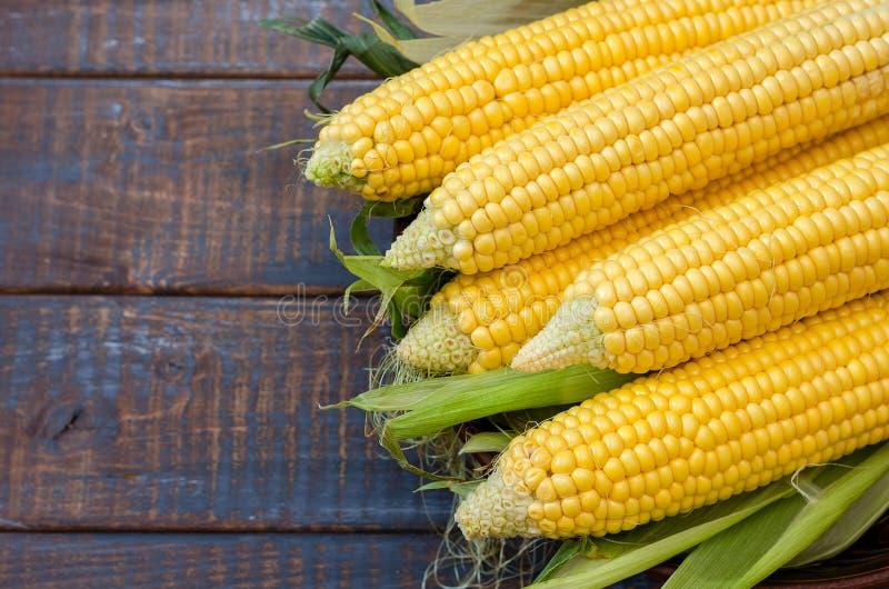 Ripe corn in a clay bowl. stock photos