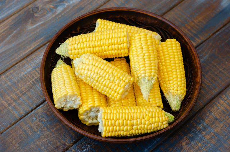 Ripe corn in a clay bowl. royalty free stock images