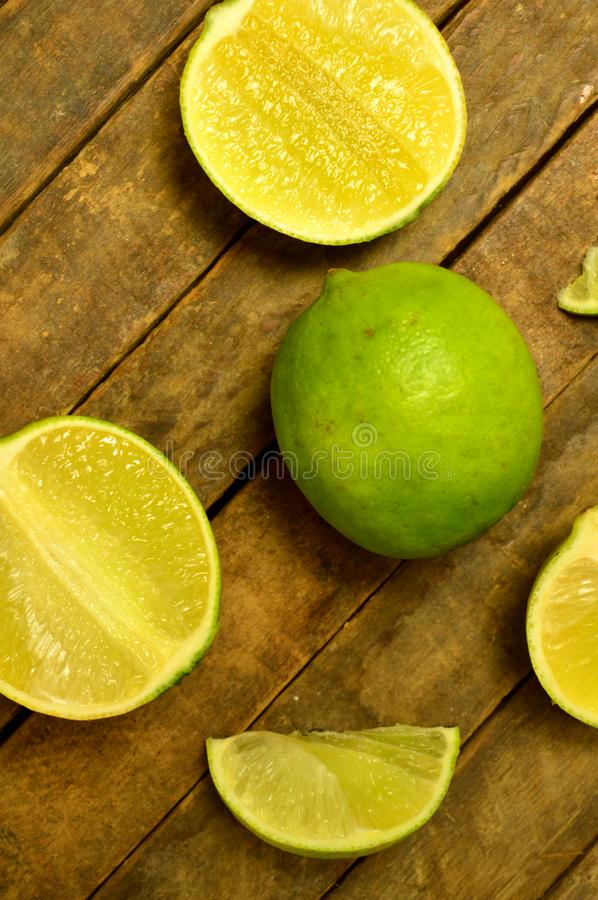 Ripe cut up limes stock photos