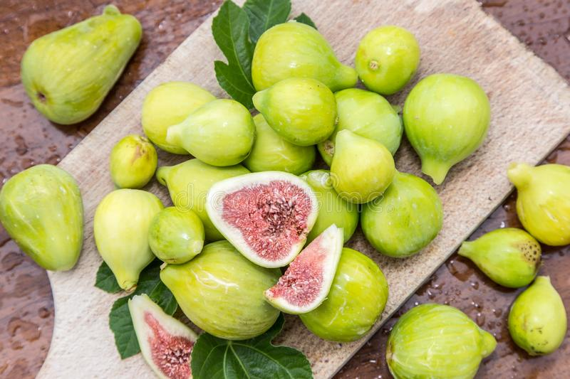 Ripe fig fruits on the wooden table stock photography