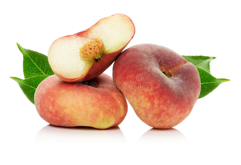 Ripe fig peach slice with leaves isolated on white background stock photography