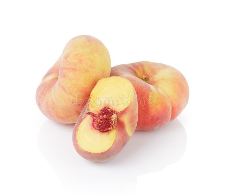 Ripe flat donut peaches royalty free stock image