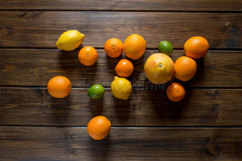 Ripe fresh grapefruits on wooden table. Top view, copy space royalty free stock photos