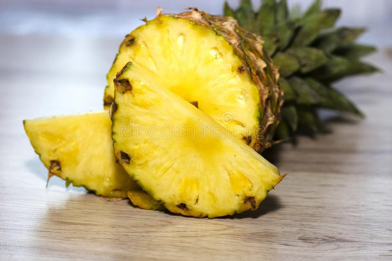 Ripe, fresh and juisy pineapples on wooden background. royalty free stock photos
