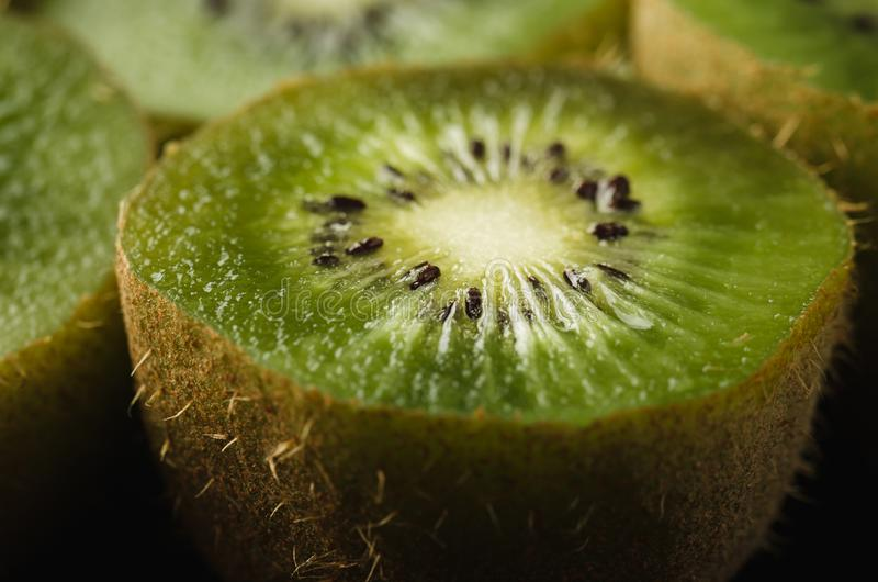 Ripe fresh kiwi on black background/Ripe fresh kiwi on black background. Close up royalty free stock photo