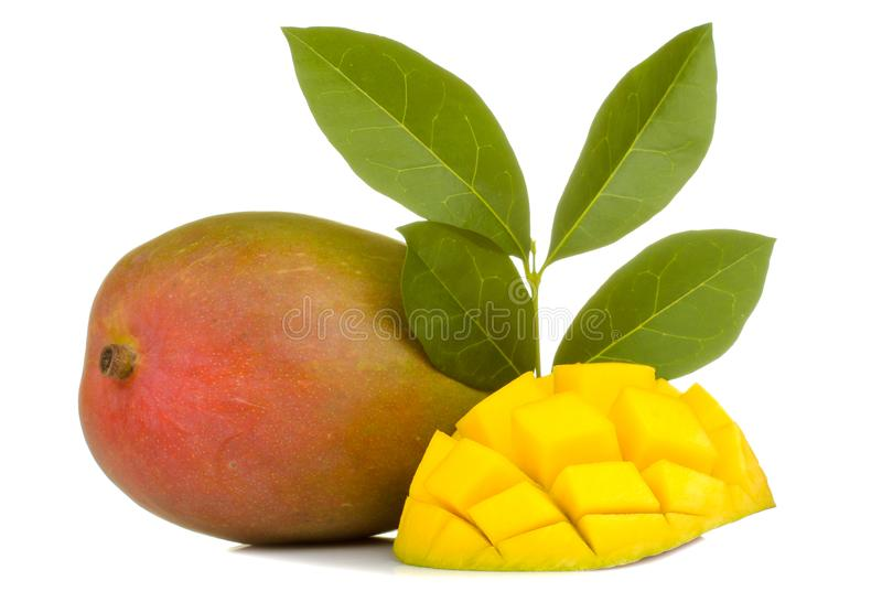 Ripe fresh mango fruit and slices and leaves on a white isolated background. tropical fruit royalty free stock images