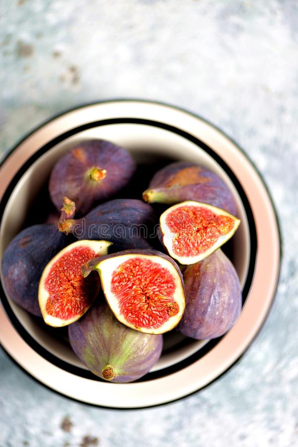 Ripe fresh organic figs on a gray background. stock photo