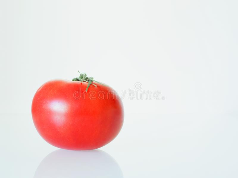 Ripe fresh red tomato on a white background stock images