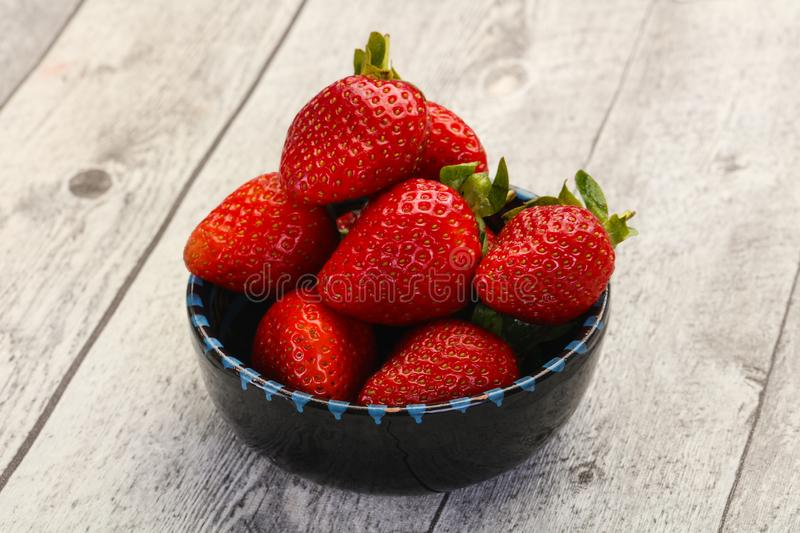 Ripe fresh Strawberry. Heap in the bowl royalty free stock image