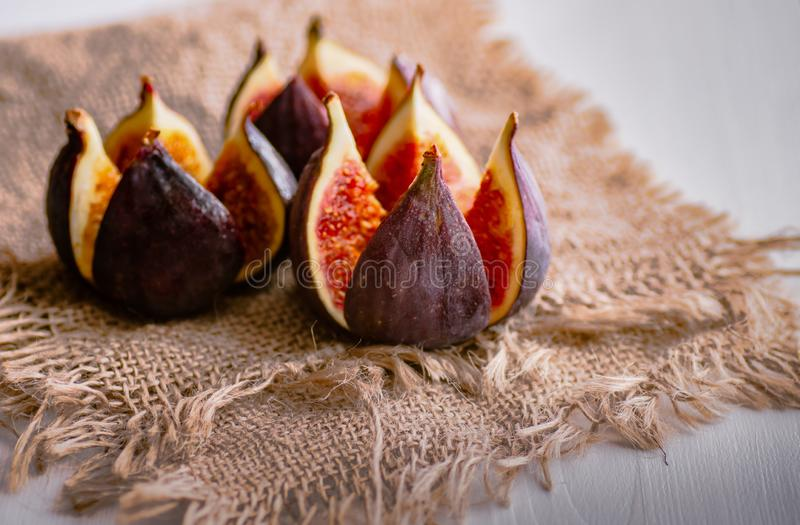 Ripe fruits of fig on burlap. Healthy food. stock images