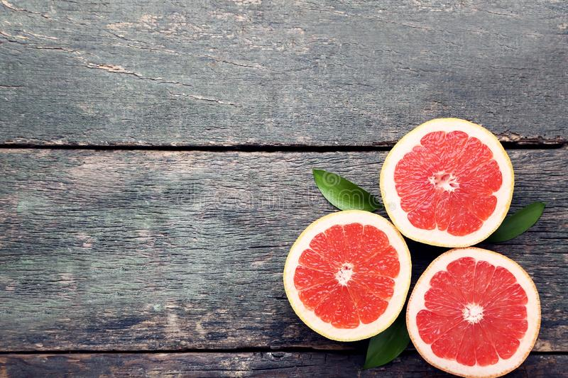 Grapefruits with green leafs royalty free stock photo