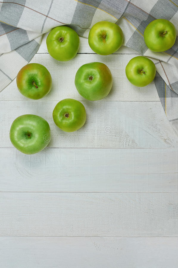 Ripe green apples on light wooden background royalty free stock image