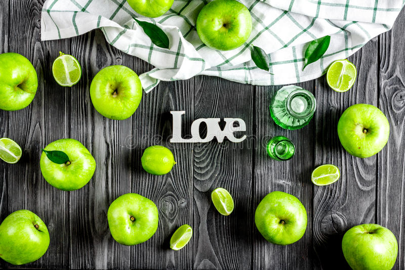 Ripe green apples with love dark wooden table background top view pattern. Ripe green apples with love on dark wooden table background top view pattern stock image