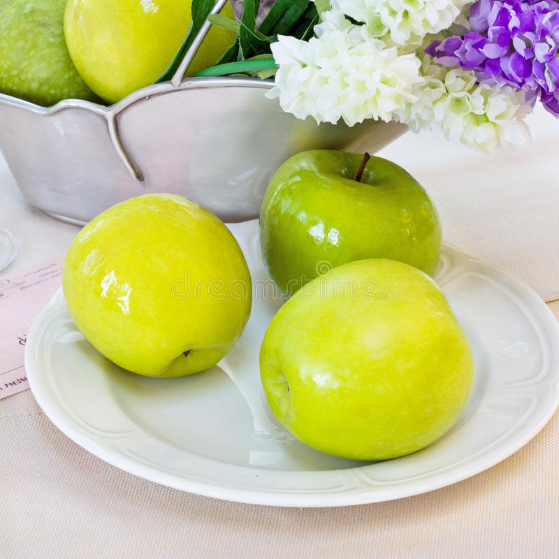 Ripe green apples on plate. stock photo