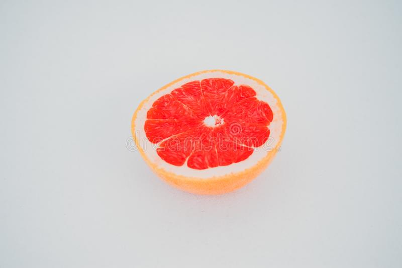 Ripe half of pink grapefruit citrus fruit on white background royalty free stock photos