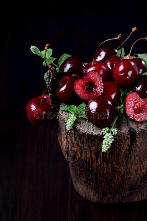 Free Ripe Juicy Cherries On Tree Stump Stock Images - 154104444