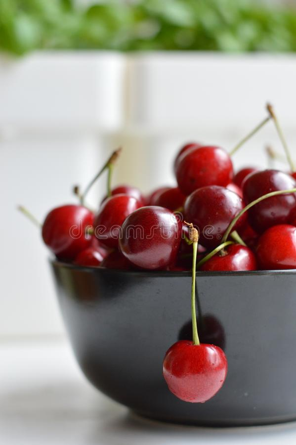 Cherry, plate, sweet cherry, black plate, ripe cherry, red, juicy, spine, royalty free stock photo