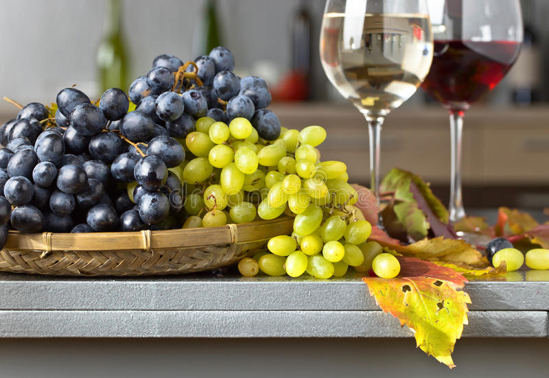 Ripe juicy grape and glass of wine royalty free stock photography