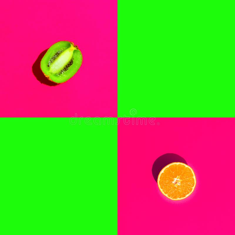 Ripe juicy halved orange kiwi on duotone bright neon fuchsia pink green background with blank squares for text royalty free stock photography