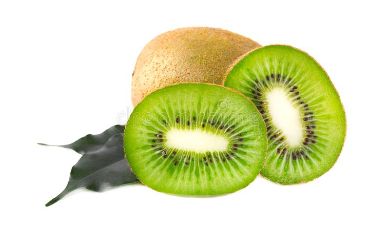 Ripe juicy kiwi slices with green leaves, isolated. On white background stock image