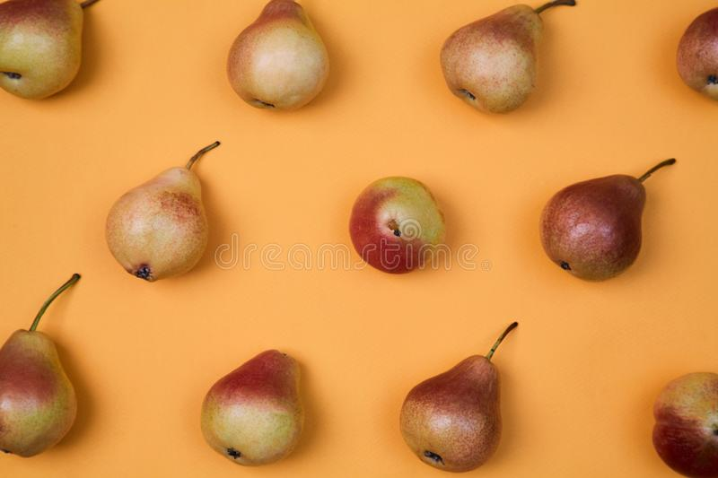 Ripe juicy pears placed on orange background. Colorful fruit pattern or background. royalty free stock photos