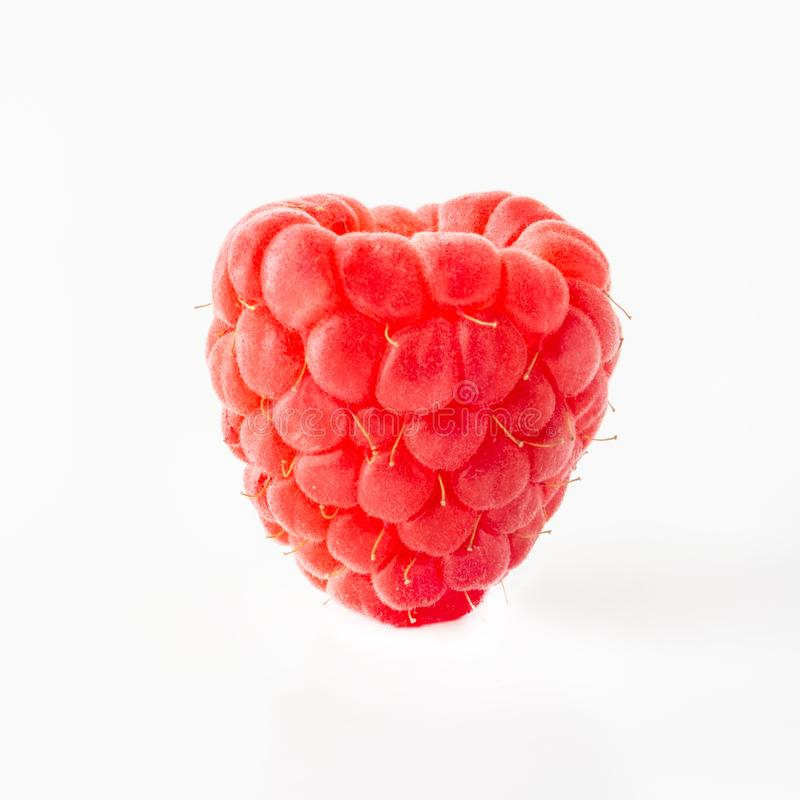 Ripe juicy raspberries on a white background, Isolated closeup, for design, vitamins, berries, fruits royalty free stock photography