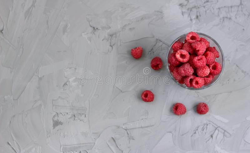 Ripe juicy raspberry in a glass stock image