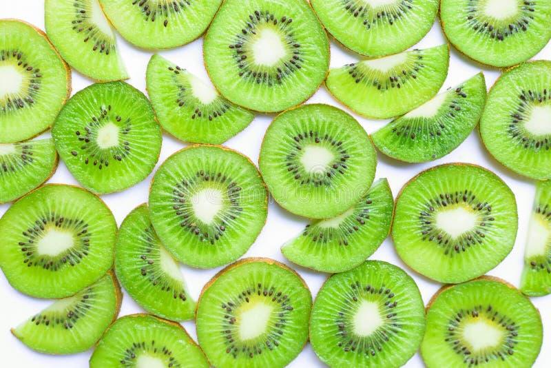 Ripe kiwi fruit slices isolated on white. Background royalty free stock image