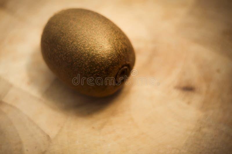 Ripe kiwi on kitchen wooden board royalty free stock photography