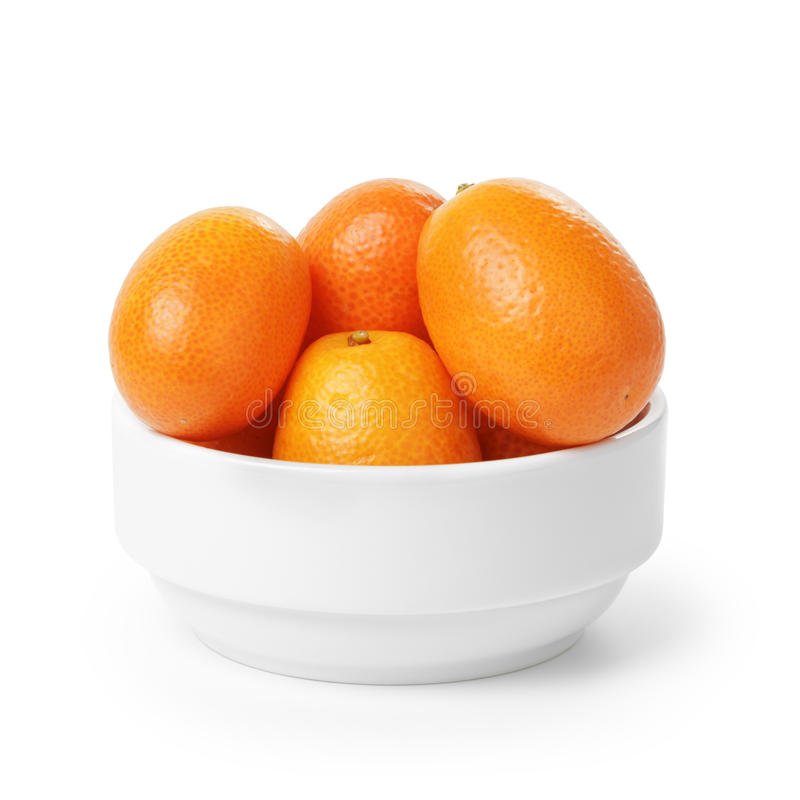 Ripe kumquat fruits in bowl royalty free stock image