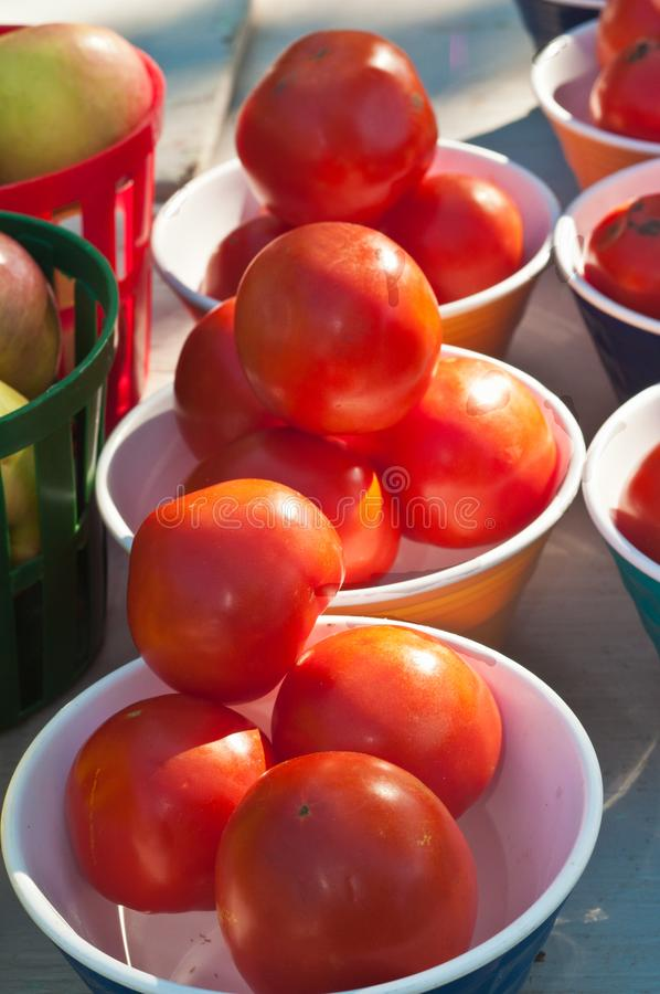 Ripe, locale tomatoes for sale at tropical farmers market stock photos