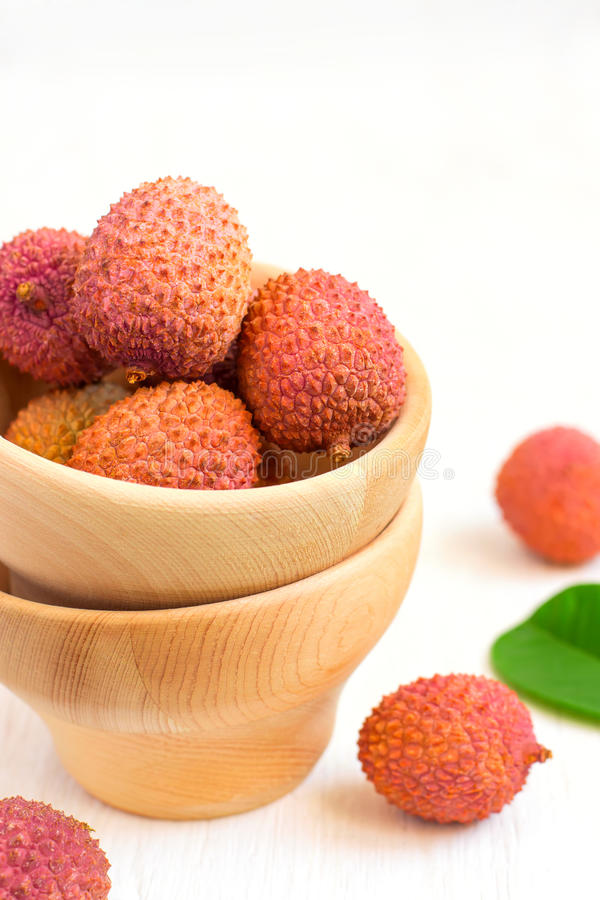 Ripe lychees in a bowl on a white background closeup, selective. Focus royalty free stock photos