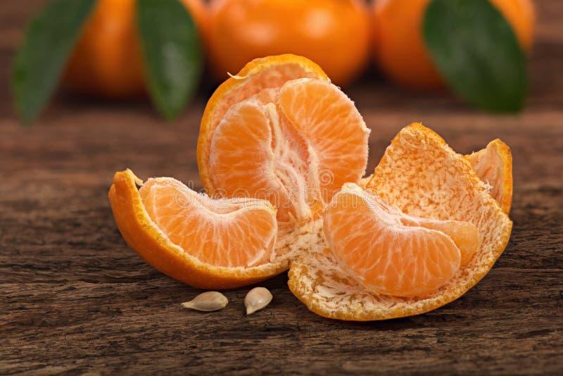 Ripe Mandarin fruit peeled open stock images