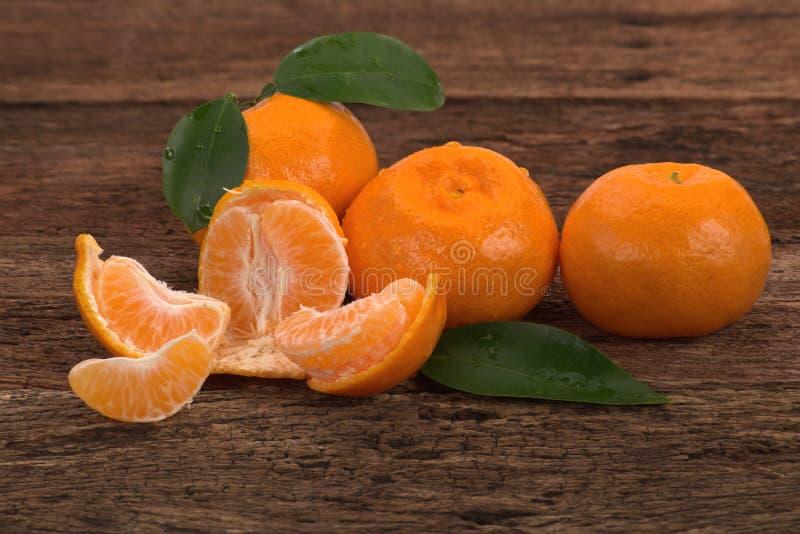 Ripe Mandarin fruits and one peeled open royalty free stock photos