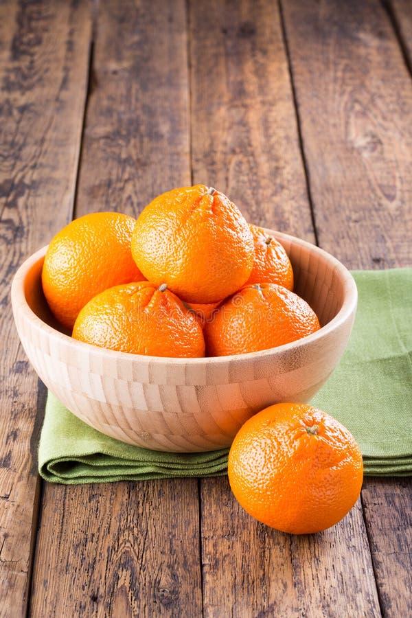 Ripe mandarins in a bowl stock photo