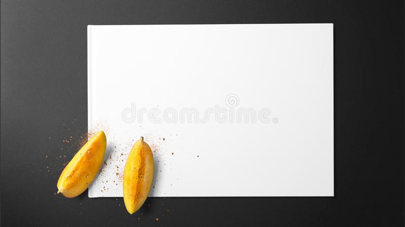 Ripe mango slice with spices on white paper royalty free stock images