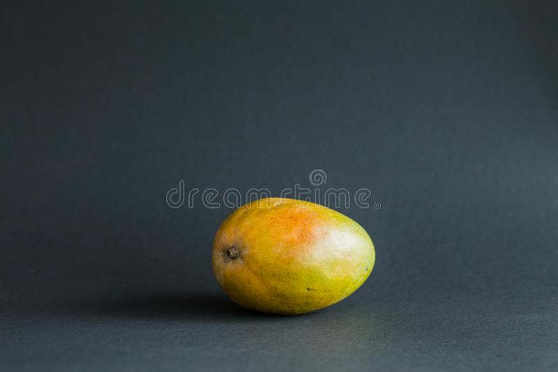 Ripe Mango Tropical Fruits On a black background stock photos