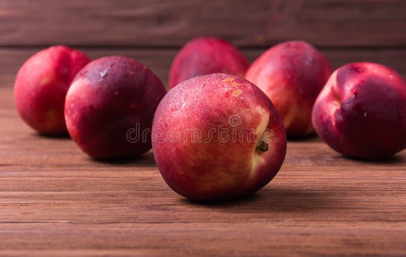 Ripe nectarine fruit. A group of ripe nectarine fruit on wooden background royalty free stock images