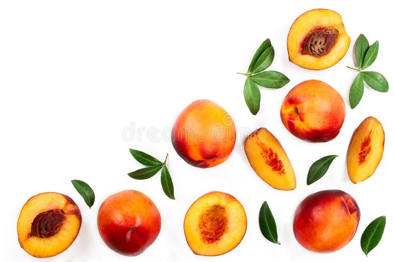 Ripe nectarine with leaves isolated on white background with copy space for your text. Top view. Flat lay pattern.  stock photo