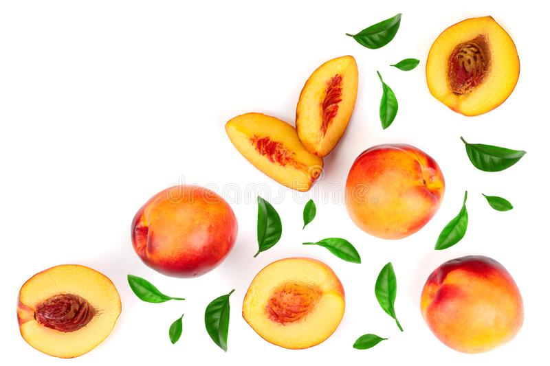 Ripe nectarine with leaves isolated on white background with copy space for your text. Top view. Flat lay pattern.  stock images