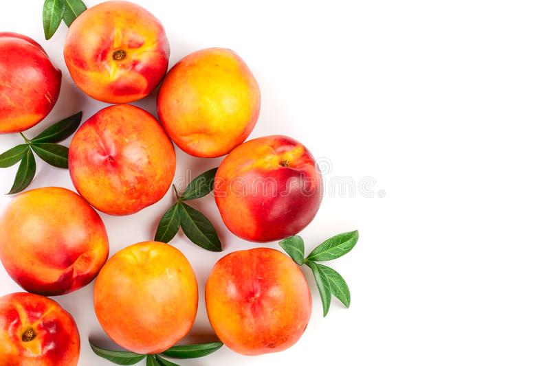 Ripe nectarine with leaves isolated on white background with copy space for your text. Top view. Flat lay pattern.  royalty free stock images