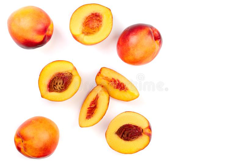 Ripe nectarine with leaves isolated on white background with copy space for your text. Top view. Flat lay pattern.  royalty free stock photos