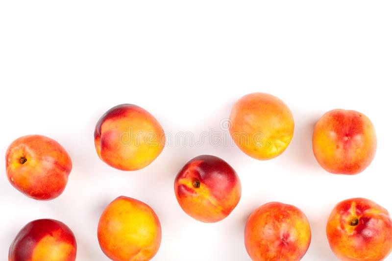 Ripe nectarine with leaves isolated on white background with copy space for your text. Top view. Flat lay pattern.  stock photos