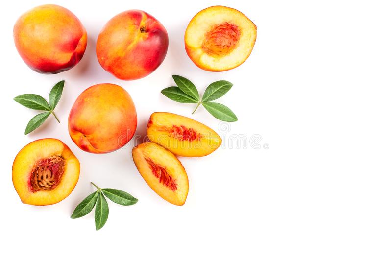 Ripe nectarine with leaves isolated on white background with copy space for your text. Top view. Flat lay pattern.  stock photography