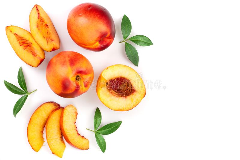 Ripe nectarine with leaves isolated on white background with copy space for your text. Top view. Flat lay pattern.  royalty free stock image