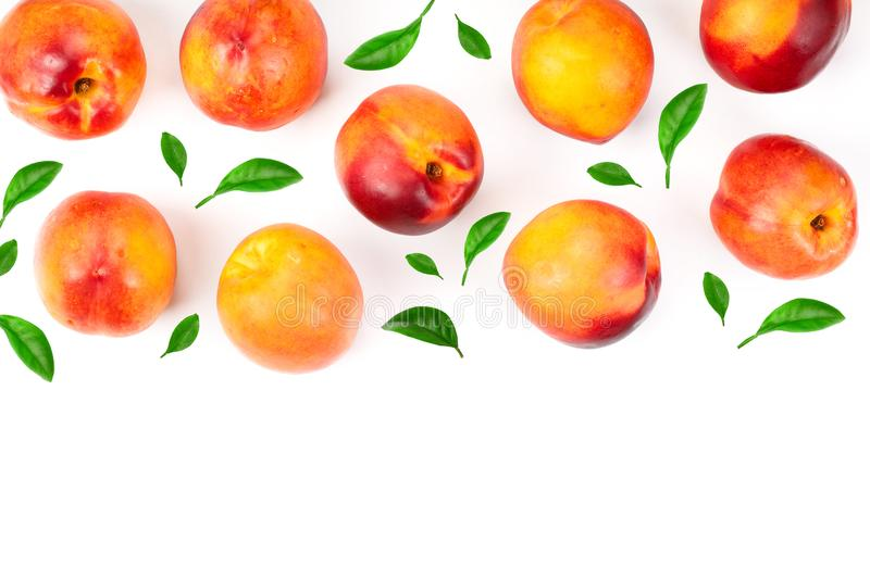Ripe nectarine with leaves isolated on white background. Top view. Flat lay pattern.  stock photography