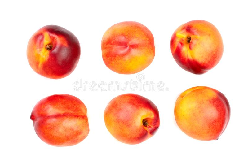 Ripe nectarine with leaves isolated on white background. Top view. Flat lay pattern. Set or collection.  stock images