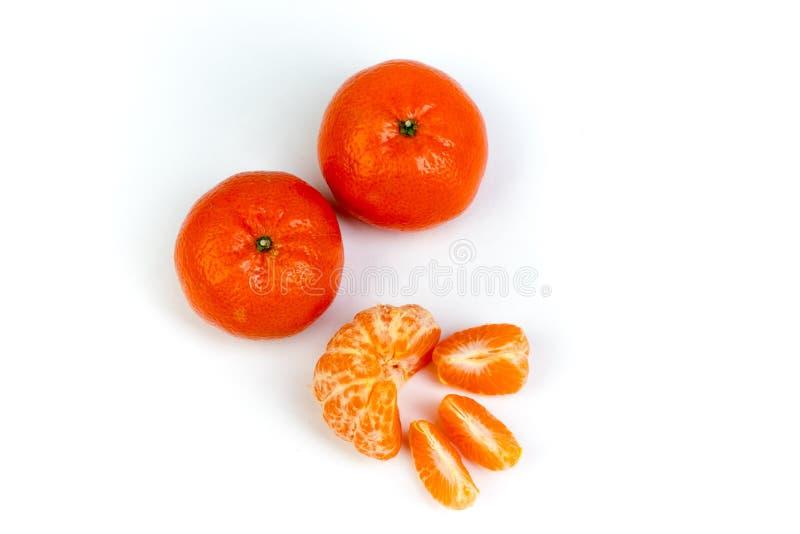 Ripe orange fresh mandarin , clean mandarin, mandarin slices,  on white background.Top view stock photography