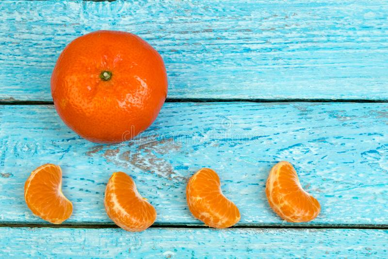 Ripe orange fresh mandarin , clean mandarin, mandarin slices, on wooden background. Top view stock photography