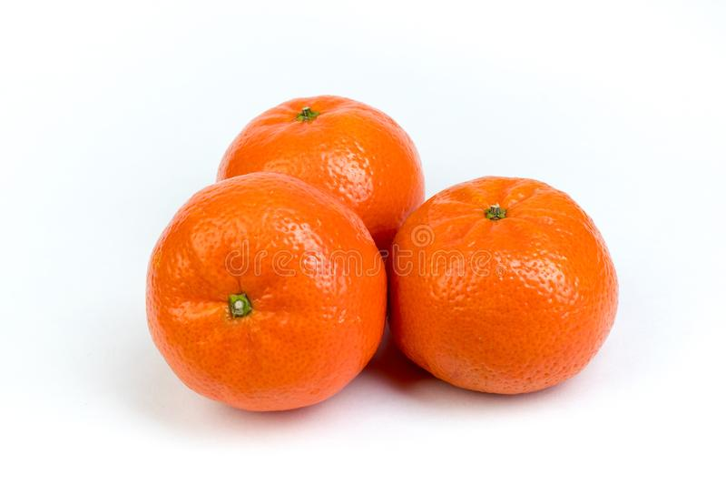Ripe orange fresh mandarin, mandarin slices, isolated on white background. royalty free stock images